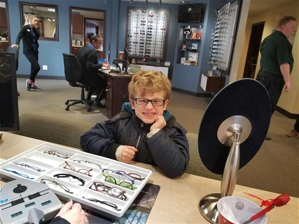 Elementary students receive a free eye exam