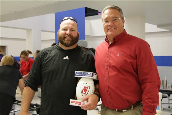 Coach Minnick with Coach of the Week Football